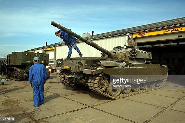 A fully operational 1949 Britishmade Centurion tank is confiscated after police were tipped for a large amount of illegal fire arms at a metal...