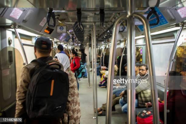 fully packed kolkata subway metro train interior - underground rail stock pictures, royalty-free photos & images