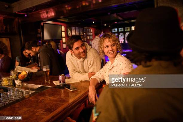 Fully vaccinated customers gather at the bar inside Risky Business, a private members-only club, that was once The Other Door but closed during the...