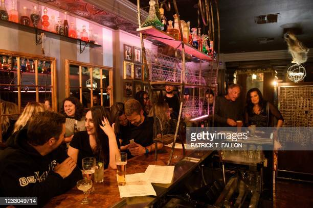 Fully vaccinated customers gather at the bar inside Risky Business, that was once The Other Door but closed during the Covid-19 pandemic in the North...