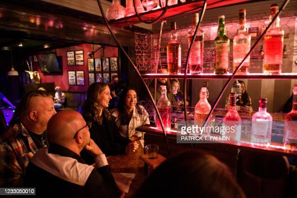 Fully vaccinated customers Julie Brown and Kelsi Teramae gather at the bar inside Risky Business, that was once The Other Door but closed during the...