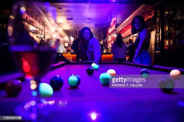 Fully vaccinated customers play pool inside Risky Business, a private members-only club, that was once The Other Door but closed during the Covid-19...