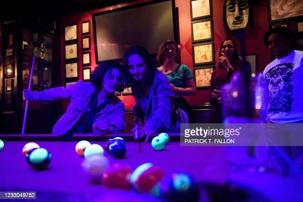 Fully vaccinated customers play pool inside Risky Business, that was once The Other Door but closed during the Covid-19 pandemic in the North...