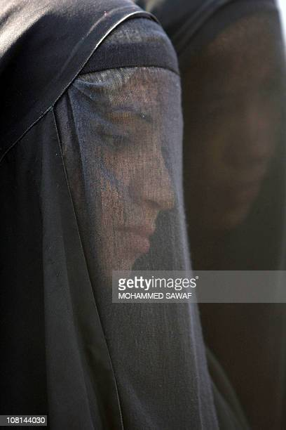 Fullyveiled Shiite Muslim women arrive on January 19 2011 in the central Iraqi shrine city of Karbala 120 kms south of the capital Baghdad to take...