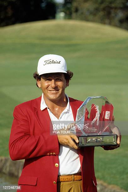 Fulton Allem poses with the tournament trophy after winning the Independent Insurance Agent Open at TPC at The Woodlands on April 7, 1991 in The...