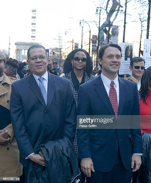 Fulton County Chairman John Eaves and Georgia State Senator Jason Carter attends the 2014 Martin Luther King Jr March Rally at Peachtree Street on...