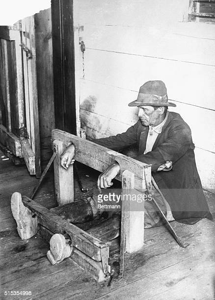 Fulton County FL Picture shows a man in stock and other kinds of punishment are used at the Bellwood Convict Camp Undated photo circa 1925