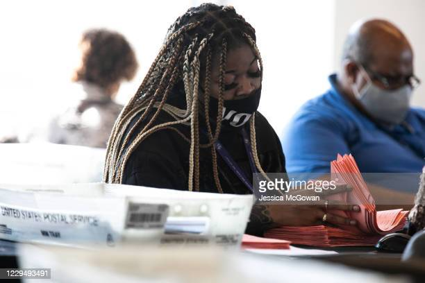 Fulton county worker continue to count absentee ballots at State Farm Arena on November 6, 2020 in Atlanta, Georgia. The 2020 presidential race...