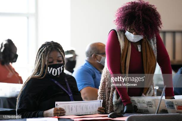 Fulton county workers continue to count absentee ballots at State Farm Arena on November 6, 2020 in Atlanta, Georgia. The 2020 presidential race...