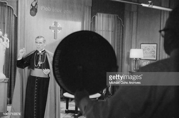 Fulton J Sheen Auxiliary Bishop of the Archdiocese of New York on the set of the television series 'Life is Worth Living' in New York City circa 1955...