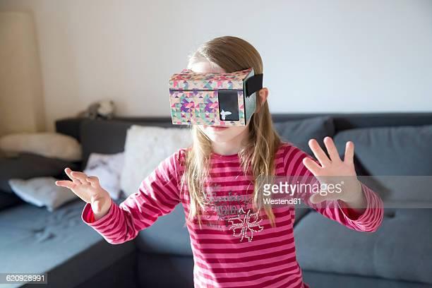 Fumbling girl with Virtual Reality Glasses