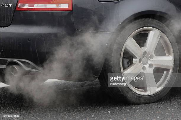 Fumes are emitted from the exhaust pipe of an Audi AG Quattro automobile in London UK on Wednesday Jan 25 2017 UK Prime Minister Theresa May said...