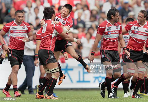 Fumiaki Tanaka of Japan celebrates victory with Takashi Kikutani after the international friendly between Japan and Wales at Prince Chichibu Stadium...
