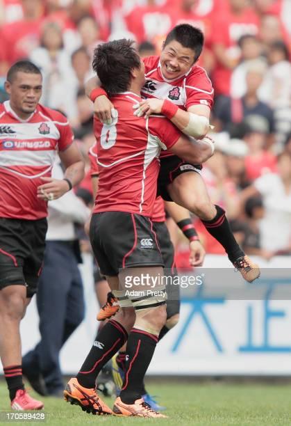 Fumiaki Tanaka of Japan celebrates victory with Takashi Kikutani after the international friendly between Japan and Wales at Prince Chichibu Stadium...