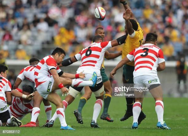 Fumiaki Tanaka of Japan kicks the ball upfield during the rugby union international match between Japan and Australia Wallabies at Nissan Stadium on...
