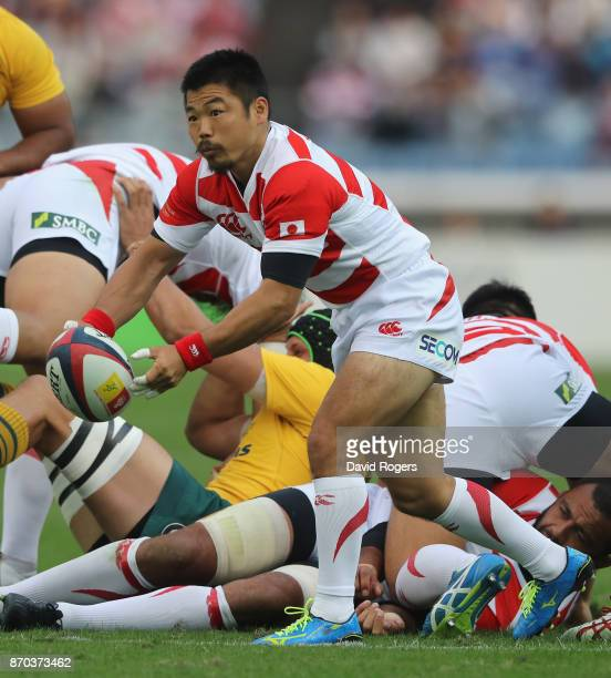 Fumiaki Tanaka of Japan passes the ball during the rugby union international match between Japan and Australia Wallabies at Nissan Stadium on...