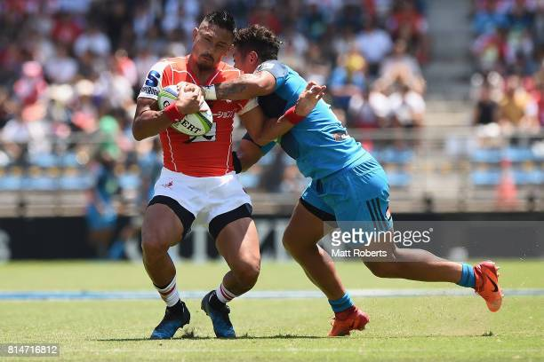Fumiaki Tanaka of the Sunwolves is tackled by Augustine Pulu of the Blues during the Super Rugby match between the Sunwolves and the Blues at Prince...