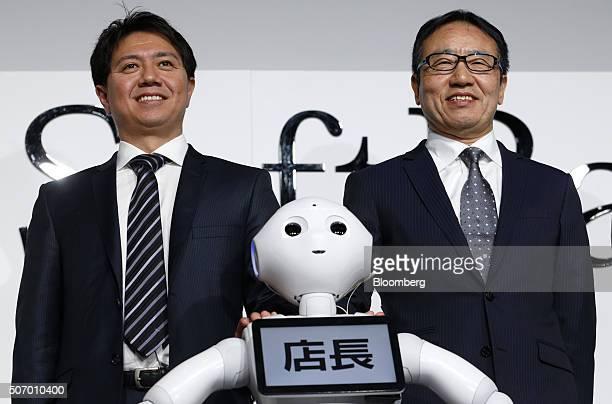 Fumihide Tomizawa, chief executive officer of SoftBank Robotics, left, and Ken Miyauchi, president and chief executive officer of SoftBank Mobile...