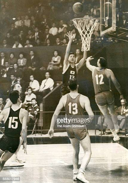 Fumihiko Moroyama of Japan scores in the Basketball Group A match between Japan and Canada at the Yoyogi National Gymnasium during the Tokyo Summer...