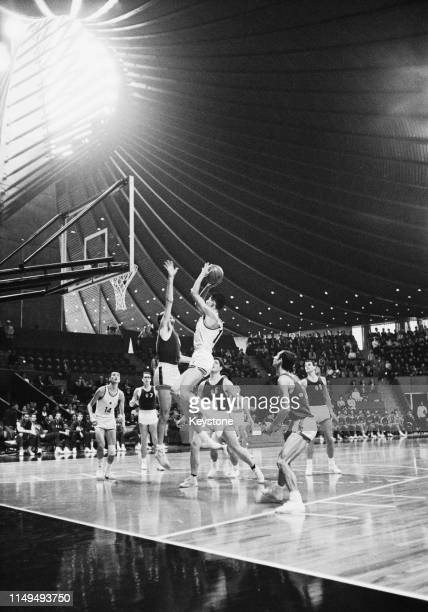 Fumihko Muroyama of Japan shoots against Italy during the Men's Olympic Basketball Tournament group A match on 17th October 1964 during the XVIII...