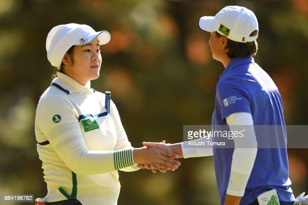 Fumika Kawagishi of Japan and LeeAnne Pace of South Africa shake hands on the 14th hole during the second round of the Queens at Miyoshi Country Club...