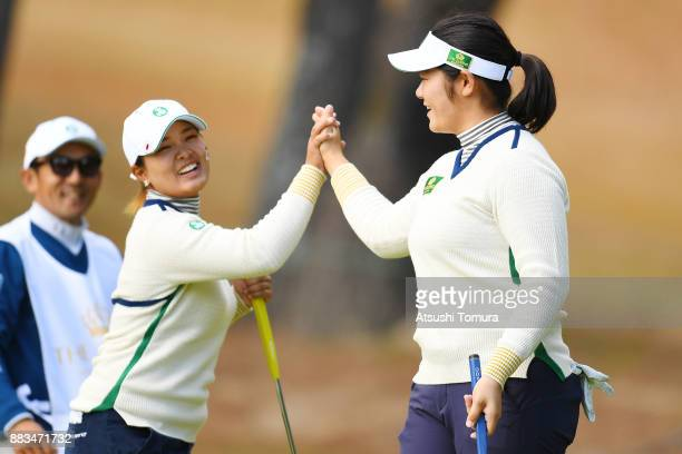 Fumika Kawagishi of Japan celebrates after making her birdie putt on the 6th hole with her team mate Ai Suzuki of Japan during the first round of the...