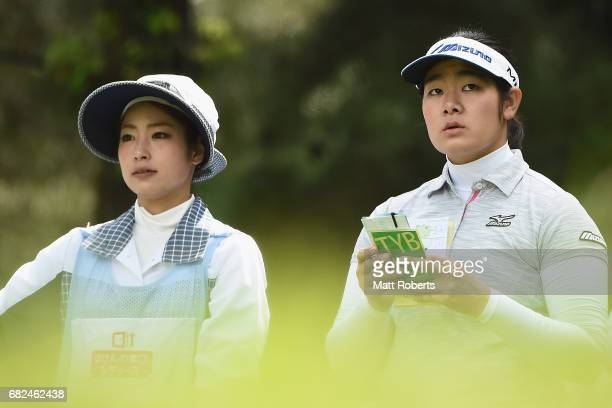 Fumika Kawagishi of Japan looks on before her tee shot on the 12th hole during the first round of the HokennoMadoguchi Ladies at the Fukuoka Country...