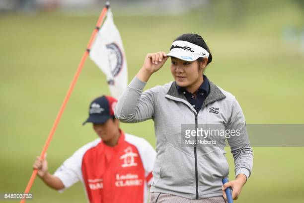 Fumika Kawagishi of Japan reacts after her putt on the 18th green during the final round of the Munsingwear Ladies Tokai Classic 2017 at the Shin...