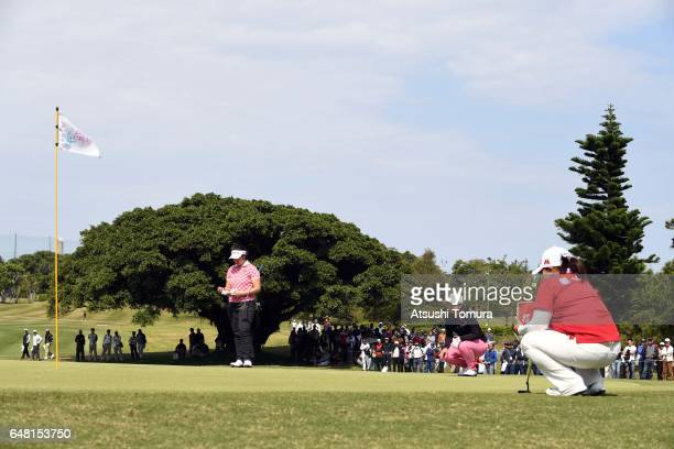 Fumika Kawagishi of Japan Satsuki Oshiro of Japan and SunJu Ahn of South Korea prepare to putt on the 17th green during the final round of the Daikin...
