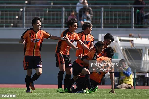 Fumitaka Kiatani of Renofa Yamaguchi celebrates the equaliser with his team mates during the JLeague match between FC Gifu and Renofa Yamaguchi at...