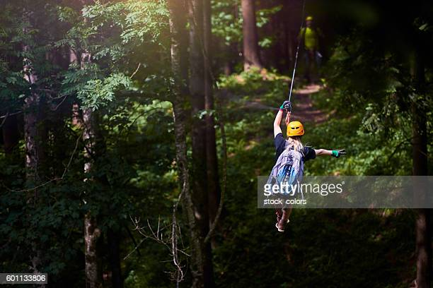 fun, adrenaline and adventure on the zip line - adventure stock pictures, royalty-free photos & images
