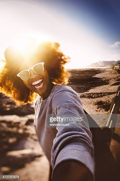 fun afro teen hipster taking selfie of herself at beach - funny black girl stock photos and pictures
