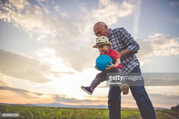 fun and happy family times - grandfather stock pictures, royalty-free photos & images