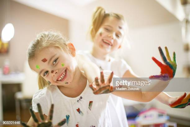 fun at home. - 4 girls finger painting stock photos and pictures