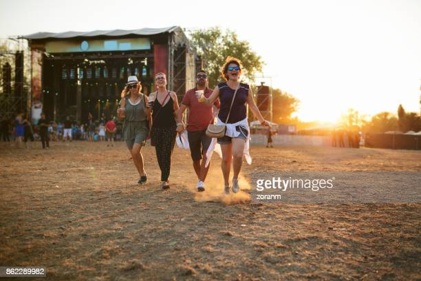 fun at music festival - geographical locations stock pictures, royalty-free photos & images