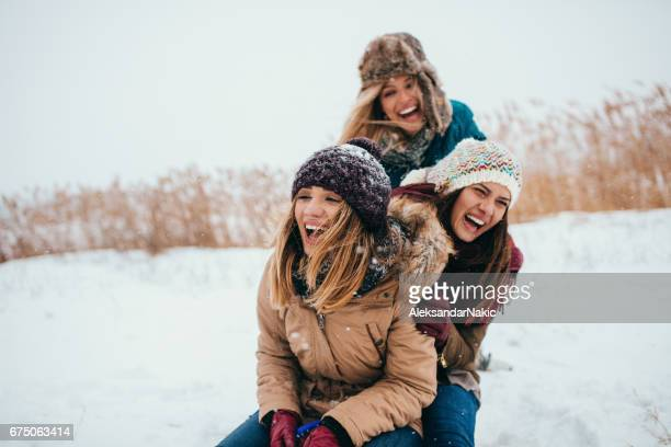 fun at the sleigh - girlfriend stock pictures, royalty-free photos & images