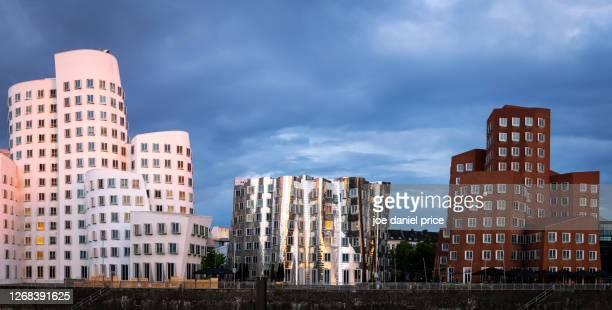 fun buildings, neuer zollhof, dusseldorf, germany - düsseldorf stock-fotos und bilder