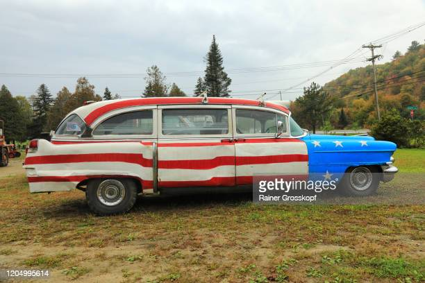 a fun car based on a 1954 cadillac deville, painted in the colors of the american flag, - rainer grosskopf stock pictures, royalty-free photos & images