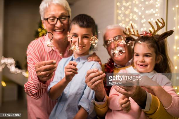 fun christmas with grandpa and grandma - new year 2020 stock photos and pictures