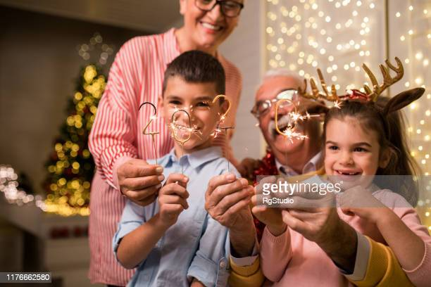 fun christmas with grandparents - happy new year 2020 stock photos and pictures