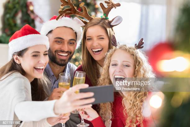 Fun friends pose for selfie during Christmas holdiay