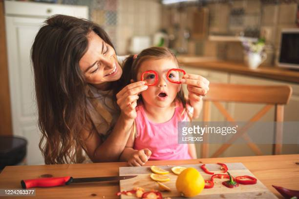 fun healthy cooking - family with one child stock pictures, royalty-free photos & images