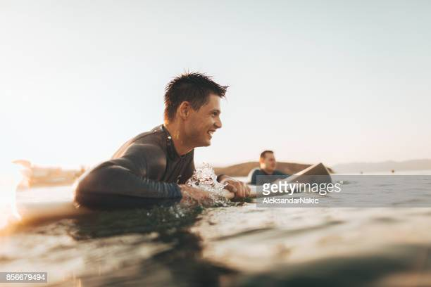 fun in the ocean - male friendship stock pictures, royalty-free photos & images