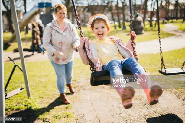 fun in the park with mum - swinging stock pictures, royalty-free photos & images