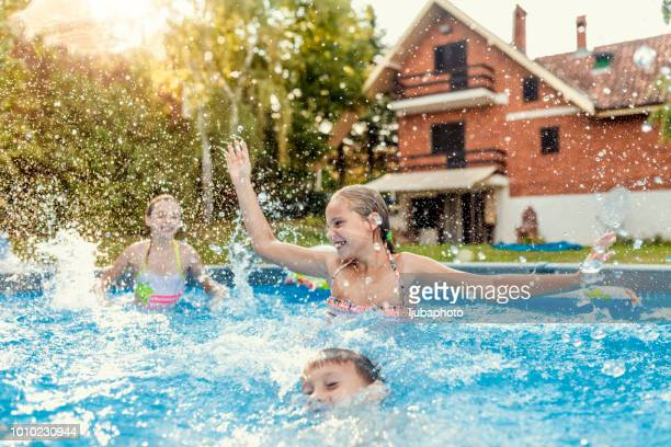 fun in the pool - pool party stock pictures, royalty-free photos & images