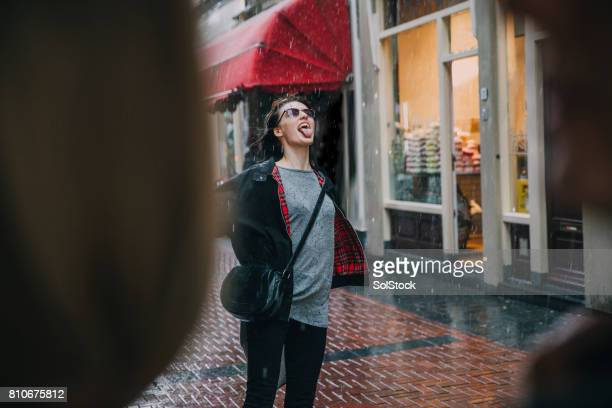 fun in the rain - may stock pictures, royalty-free photos & images