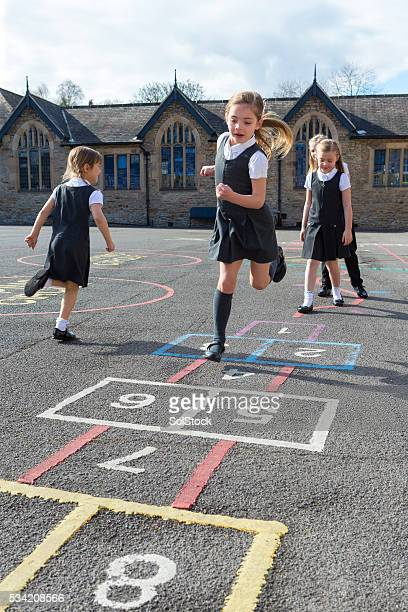 fun in the school yard - hopscotch stock pictures, royalty-free photos & images