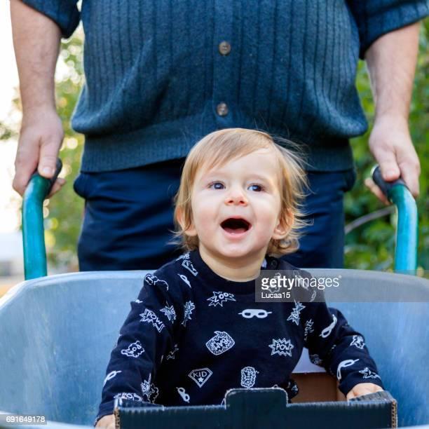 fun in the wheelbarrow - europäischer abstammung stock pictures, royalty-free photos & images