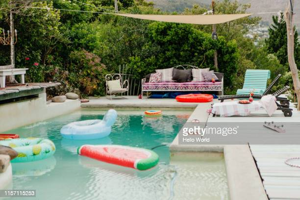 fun looking pool and poolside - pool party stock pictures, royalty-free photos & images