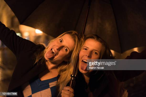 fun loving twin sisters with their tongue out - insanity stock pictures, royalty-free photos & images